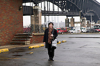 12 March 2006 - New Jersey, USA - A participant in a bus tour of locations featured in the hit television mob show The Sopranos poses for a photograph at a site near the Pulaski Skyway in New Jersey, USA, used in a murder scene, 12 March 2006. Photo Credit: David Brabyn/Sipa Press
