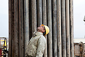 BAGHDAD, IRAQ: A worker at the drilling tower of well number 7 at the Midland Oil Company field.