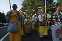 September 19, 2011, Harajuku, Tokyo, Japan - Monks chant and beat drums while marching during the 'Sayonara-Nukes' rally. Police and local media estimates put numbers attending at between 20-50,000. (Photo by Bruce Meyer-Kenny/AFLO) [3692]