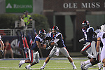 Ole Miss' Devin Thomas (29) takes a handoff from Ole Miss' Zack Stoudt (8) at Vaught-Hemingway Stadium in Oxford, Miss. on Saturday, September 10, 2011.