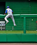 22 June 2008: Texas Rangers' left fielder Brandon Boggs climbs the outfield fence in an attempt to catch a home run ball hit by Washington Nationals' infielder Ronnie Belliard at Nationals Park in Washington, DC. The Rangers defeated the Nationals 5-3 in the final game of their 3-game inter-league series...Mandatory Photo Credit: Ed Wolfstein Photo