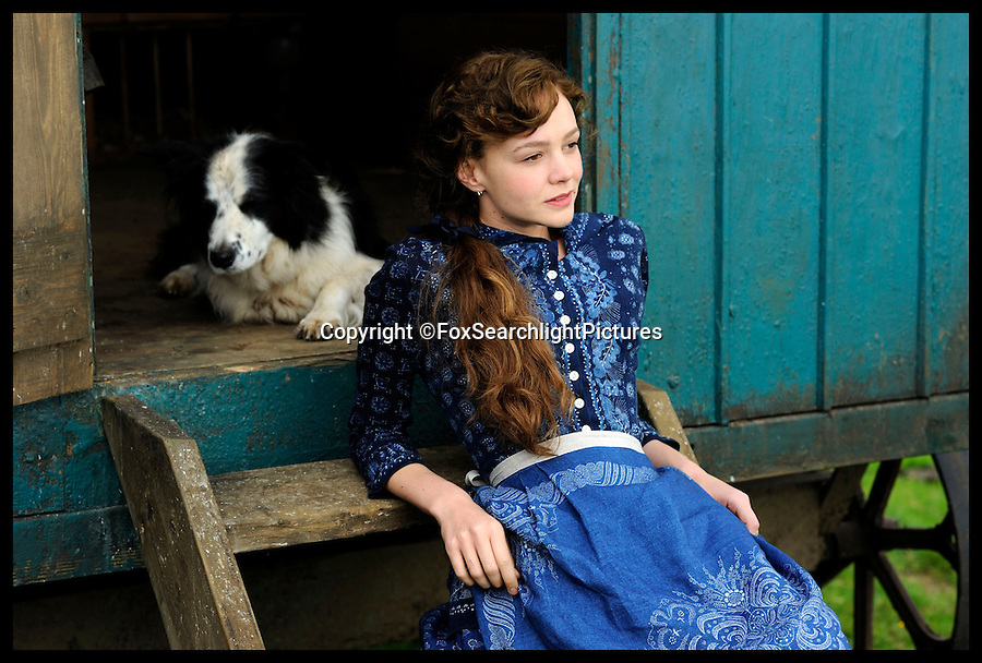 BNPS.co.uk (01202 558833)<br /> Pic: FoxSearchlightPictures/BNPS<br /> <br /> Carey Mulligan, sitting against the shepherd hut's steps on a movie still from the film.<br /> <br /> A shepherd's hut used by the real-life Gabriel Oak, the main love interest in the new movie Far From the Madding Crowd, has been saved from ruin after being found abandoned in a hedgerow.<br /> <br /> The cabin on wheels belonged to Waterston Manor, the inspiration for fictional Weatherbury Farm which Carey Mulligan's character Bathsheba Everdene owns in the film adaptation of the Thomas Hardy classic novel.<br /> <br /> It has been returned to its former glory by historian David Morris.