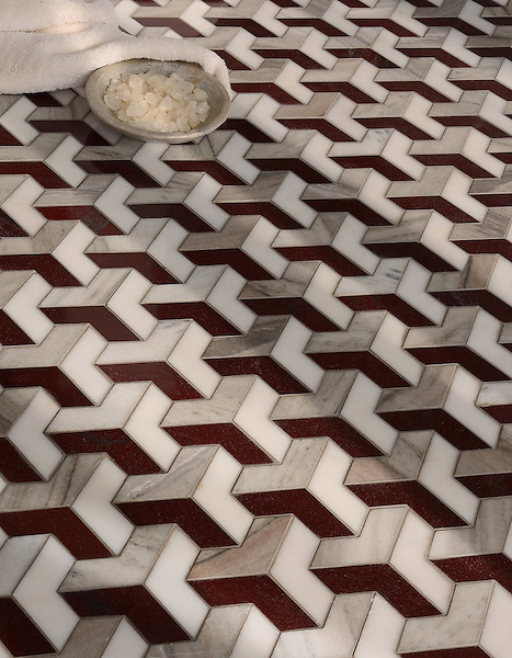 Francois, a waterjet mosaic shown in  polished Red Lake, polished Afyon, White, and honed Horizon, is part of the Illusions™ Collection by Sara Baldwin Designs for New Ravenna.