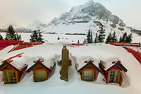 The snowy rooftop of the Num-Ti Jah Lodge (with Mount Crowfoot in the background), Banff National Park, Alberta, Canada