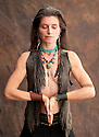 Wild Prayer. Beautiful wild spirit woman in shamnic yoga prayer.