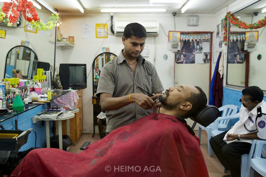 Malaysia, Kuala Lumpur. A barber shop.