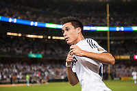 Jose Maria Callejon (21) of Real Madrid celebrates scoring. Real Madrid defeated A. C. Milan 5-1 during a 2012 Herbalife World Football Challenge match at Yankee Stadium in New York, NY, on August 8, 2012.