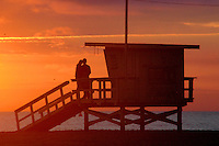A couple embrace amid the sunset at Santa Monica Beach on Wednesday, October 20, 2010.