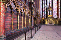 Long side view of the nave with altar and reliquary in the distance, Upper chapel of La Sainte-Chapelle (The Holy Chapel), 1248, Paris, France. La Sainte-Chapelle was commissioned by King Louis IX to house his collection of Passion Relics, including the Crown of Thorns. The Sainte-Chapelle is considered among the highest achievements of the Rayonnant period of Gothic architecture. Picture by Manuel Cohen