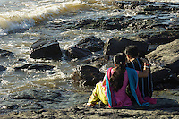 """A young Indian couple. The fort area in Mumbai is very popular with young people, """"lovers Lane or better better called beach"""", every afternoon, getting away from trafic and the city"""