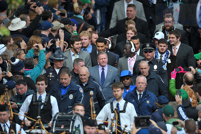 Oct. 20, 2012; Head coach Brian Kelly walks with the football team to Notre Dame Stadium...Photo by Matt Cashore.