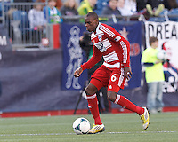 FC Dallas midfielder Jackson Goncalves (6) brings the ball forward. .  In a Major League Soccer (MLS) match, FC Dallas (red) defeated the New England Revolution (blue), 1-0, at Gillette Stadium on March 30, 2013.
