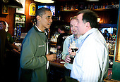 United States President Barack Obama (L) talks with patrons as he visits a bar in celebration of St. Patrick's day at the Dubliner Restaurant and Pub on March 17, 2012 in Washington, DC. Next week, Obama and Vice President Biden will meet the Irish Prime Minister Enda Kenny and attend a St. Patrick's Day lunch at the Capitol. .Credit: Joshua Roberts / Pool via CNP