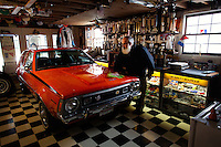 Reinholds, Pennsylvania, February 10, 2015 - Brian Moyer polishes his 1970 AMi (Australian Motor Industries) Gremlin in one of his garages. This one-of-a-kind car is the only one produced by AMI - used to sell the Gremlin to the Australian market it never took off due, Moyer says, to the limited space of the second row. He is still in the process of fully restoring it. It has a right-side steering but the windshield wipers are set for a left-side steering car. Moyer says that AMI got that one backwards for this model. <br /> <br /> Moyer owns 16 AMC Gremlins. The Gremlin was introduced on April Fools Day (April 1) in 1970 featuring a shortened Hornet body with a Kammback tail and was manufactured in the US via AMC and in Mexico via AMC's subsidiary VAM. It's lifecycle ended in 1978 when it was replaced by the AMC Spirit. Moyer became interested as a kid when he saw the early Gremlin commercials in 1970. His first car was a Gremlin and he has never not owned one. Today he has arguably the most unique collection of Gremlins in the world, including several that are one-of-a kind models. <br /> <br /> CREDIT: Daryl Peveto for The Wall Street Journal<br /> Photo Assignment ID: 36892 <br /> Slug: MYRIDE_Gremlin