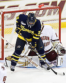 Brandon Brodhag (Merrimack - 12) screens John Muse (BC - 1) on Karl Stollery's goal which opened scoring in the game. - The Boston College Eagles defeated the visiting Merrimack College Warriors 3-2 on Friday, October 29, 2010, at Conte Forum in Chestnut Hill, Massachusetts.