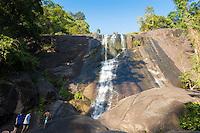 Climbing the huge rocks of Langkawi Telaga Tujuh waterfalls