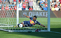 New York defender Wilman Conde (2) makes a sliding save of a sure goal.  The Chicago Fire defeated the New York Red Bulls 3-1 at Toyota Park in Bridgeview, IL on June 17, 2012.