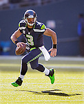 Seattle Seahawks quarterback Russell Wilson scrambles against the Tampa Bay Buccaneers at CenturyLink Field in Seattle, Washington on  November 3, 2013.  Wilson ran for 36 yards, completed 19 0f 26 passes for 217 yards, had two passes intercepted and threw for two touchdowns as the Seahawks came from behind to beat the Buccaneers 27-24 in overtime.  ©2013. Jim Bryant. All Rights Reserved.