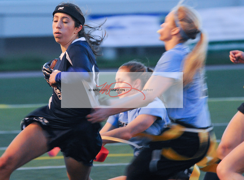 Eagle River's Jessica Scott runs past a pair of Mustang defendrs during Friday night's game with Chugiak.  Photo for the Star by Michael Dinneen