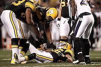 PITTSBURGH, PA - NOVEMBER 06:  Hines Ward #86 of the Pittsburgh Steelers lays on the ground around teammates after being hit by Ray Lewis #52 of the Baltimore Ravens during the game on November 6, 2011 at Heinz Field in Pittsburgh, Pennsylvania.  (Photo by Jared Wickerham/Getty Images)