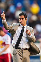New York Red Bulls head coach Mike Petke salutes the fans after the match. The New York Red Bulls and the Columbus Crew played to a 2-2 tie during a Major League Soccer (MLS) match at Red Bull Arena in Harrison, NJ, on May 26, 2013.