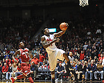 "Ole Miss' Murphy Holloway (31) vs. Arkansas' Mardracus Wade (1) at the C.M. ""Tad"" Smith Coliseum in Oxford, Miss. on Saturday, January 19, 2013. Mississippi won 76-64. (AP Photo/Oxford Eagle, Bruce Newman)"