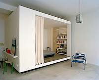 A large contemporary curtained box bed is an ingenious space saving idea in the open plan live/work space