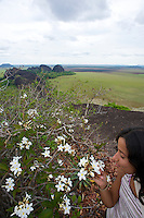 Smelling the flowers on top of Tepuy mesa - View in the dry season in the Llanos plains, home of the oldest rock formations in the world - Colombia - South America
