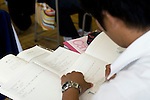 A student takes notes during a Korean Language class at the Tokyo Korean High School in Tokyo, Japan on Thursday 07 October, 2010..Photographer: Robert Gilhooly
