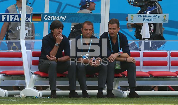 Germany coach Joachim Loew watches his team warm up