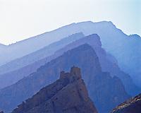 Mountain Ridges & Persian Ruin, Sultanate of Oman Western Hagar Mountains   2,000 year old castle remains   Arabian Pennisula