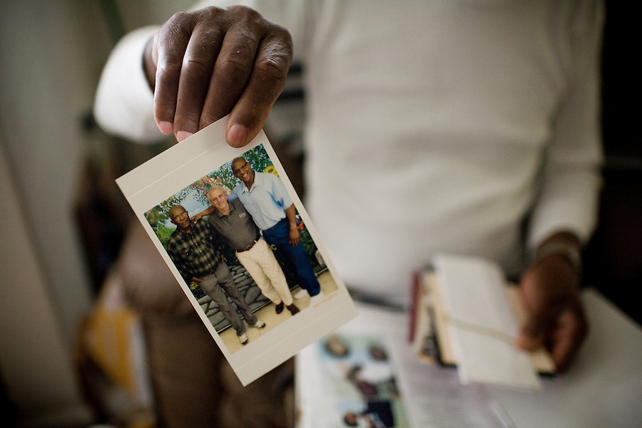 Robert Dixon, Sr., holds up an old photograph of himself, right, with a family friend, middle and his son, Robert Dixon, Jr., at his home, in Stockton, Ca., on Saturday, May 14, 2011. His son, Robert Dixon, Jr., was denied parole after a psychological evaluation deemed him a psychopath despite transforming his life through completing education courses and self-improvement seminars.