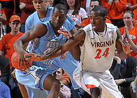 Jan. 8, 2011; Charlottesville, VA, USA; North Carolina Tar Heels forward Harrison Barnes (40) steals the ball from Virginia Cavaliers guard K.T. Harrell (24) during the game at the John Paul Jones Arena. Mandatory Credit: Andrew Shurtleff
