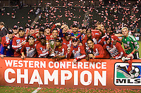 Midfielder David Ferreira of FC Dallas holds and kisses the MLS Western Conference Championship trophy with his teammates. FC Dallas defeated the LA Galaxy 3-0 to win the Western Division 2010 MLS Championship at Home Depot Center stadium in Carson, California on Sunday November 14, 2010.