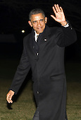 United States President Barack Obama waves to the press as he arrives on the South Lawn of the White House following a trip to Orlando, Florida to promote foreign tourism and a series of fundraisers in New York City on January 20, 2012. .Credit: Kristoffer Tripplaar  / Pool via CNP