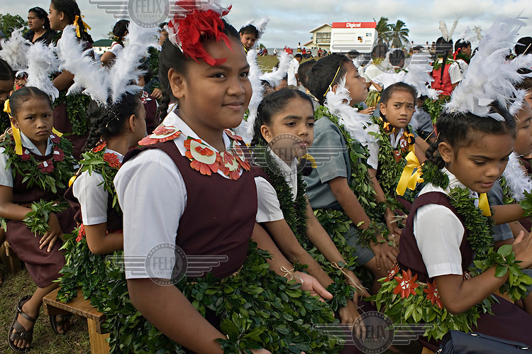 Primary school children prepare for their  performance at the Education and Cultural Day on the first day of official celebrations marking the coronation of King George Tupou V.