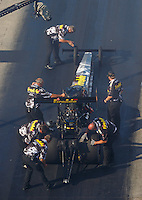 Jun 17, 2016; Bristol, TN, USA; Crew members with NHRA top fuel driver Leah Pritchett during qualifying for the Thunder Valley Nationals at Bristol Dragway. Mandatory Credit: Mark J. Rebilas-USA TODAY Sports