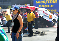 Apr. 3, 2011; Las Vegas, NV, USA: NHRA funny car driver Ashley Force Hood looks on from the starting line during the Summitracing.com Nationals at The Strip in Las Vegas. Force Hood is sitting out the 2011 season due to pregnancy. Mandatory Credit: Mark J. Rebilas-
