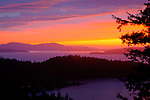 Washington, Puget Sound, Bellingham. An incredible autumn sunset over the islands in Puget Sound.