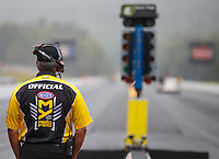 Sept 30, 2016; Mohnton, PA, USA; NHRA  chief starter Mike Gittings looks on as safety safari crews attempt to dry the track during a rain delay to qualifying for the Dodge Nationals at Maple Grove Raceway. Mandatory Credit: Mark J. Rebilas-USA TODAY Sports