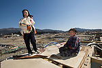 Fujiko Sato, 27, and her 4-month-old daughter Hisako and grandmother Fujiko, (82),  visit their flattened home for the fist time since the March 11 quake and tsunami hit Rikuzentakata, Iwate Prefecture, Japan on 06 April, 2011. .Photographer: Robert Gilhooly