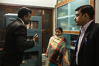 The Guria lawyers try to intimidate Brinda (center) during a mock trial with the legal team in preparation for her final witness court appearance in the Guria office in Varanasi, Uttar Pradesh, India on 23 November 2013. She is one of the 57 underaged and trafficked girls rescued from the Shivdaspur red light area in Varanasi, who has been fighting a court case against her traffickers and brothel owners for the past 8 years.