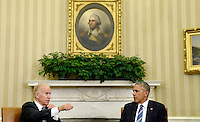United States Vice President Joe Biden speaks as US President Barack Obama looks on while discussing the release of the Cancer Moonshot Report in the Oval Office of the White House on October 17, 2016 in Washington, DC. <br /> Credit: Olivier Douliery / Pool via CNP /MediaPunch
