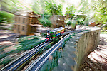 The Train Garden in the New Orleans Botanical Garden in Louisiana displays miniature trains and streetcars that travel through a replica of the city's distinctive, historical, and visually interesting French Quarter.