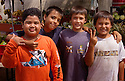 Local boys posing for photographer; Market Street Market, Wailuku, Maui, Hawaii..