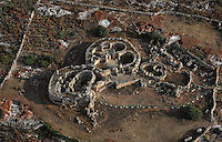Aerial view of the Mnajdra Temple complex, c.3600-3200 BC, Malta, pictured on June 5, 2008, in the morning. The Republic of Malta consists of seven islands in the Mediterranean Sea of which Malta, Gozo and Comino have been inhabited since c.5,200 BC. It has been ruled by Phoenicians (Malat is Punic for safe haven), Greeks, Romans, Fatimids, Sicilians, Knights of St John, French and the British, from whom it became independent in 1964. Nine of Malta's important historical monuments are UNESCO World Heritage Sites, including  the well preserved Mnajdra Temple complex. Spectacularly sited on the Southern coast of Malta the three temples radiate from an oval forecourt. The lower temple is astronomically aligned so that the sun's rays shine straight through the doorway on the equinoxes. Picture by Manuel Cohen.
