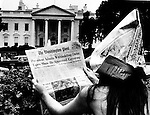 Girl reads Washington Post in front of White House about Senate Watergate committee which revealed that President Richard Nixon had a tape recording system in his offices and that he had recorded many conversations implicated the president attempt to cover up the break-in at the Democratic National Committee headquarters, Watergate scandal was a political scandal in the United States in the 1970's resulting from the break-in into the Democratic National Committee headquarters at the Watergate office complex in Washington, D.C. which ultimately lead to the resignation of President Richard Nixon,