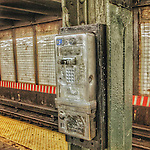 Old broken public telephone