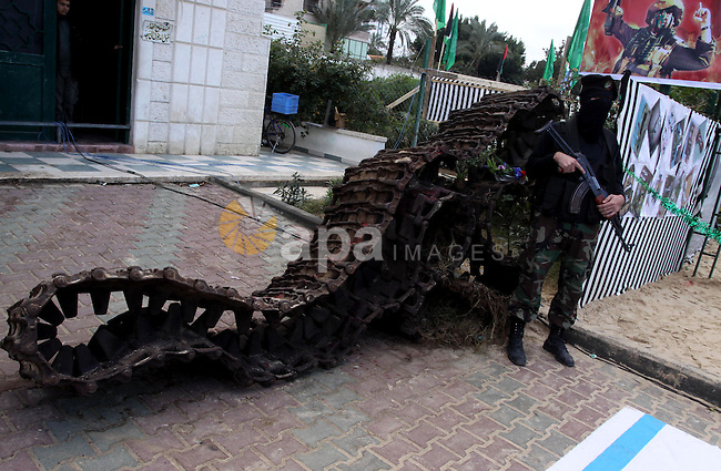 A Palestinian Hamas militant stands in front of parts of a tank during a rally marking the 2nd anniversary of Israeli war on Gaza Strip, in Gaza City on January 1, 2011. Photo by Mohammed Asad