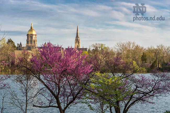 April 18, 2017; View of the Main Building and Basilica at St. Joseph Lake. (Photo by Barbara Johnston/University of Notre Dame)
